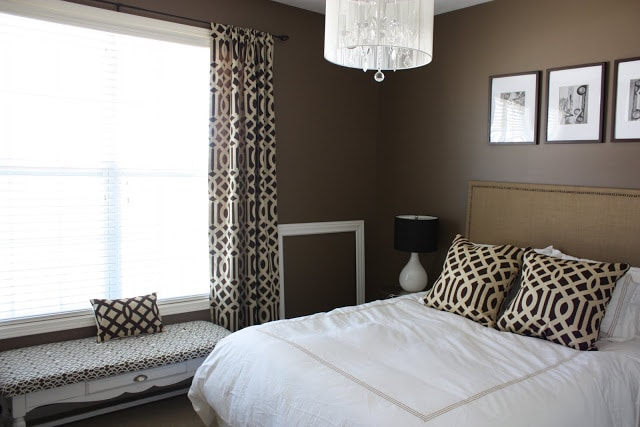 Guest bedroom with Behr Mocha Latte brown walls and white bedding