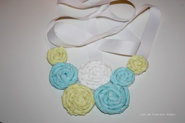 floral rosette bib necklace