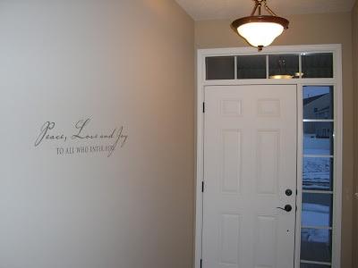 A white door with a light in front of the door.