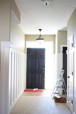Painting the front door black.