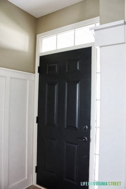 Black front door interior with white board and batten walls