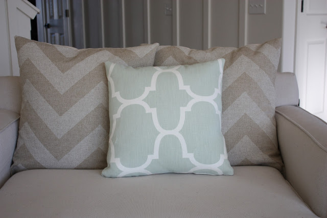 Windsor Smith Riad in Seafoam pillow on the loveseat.