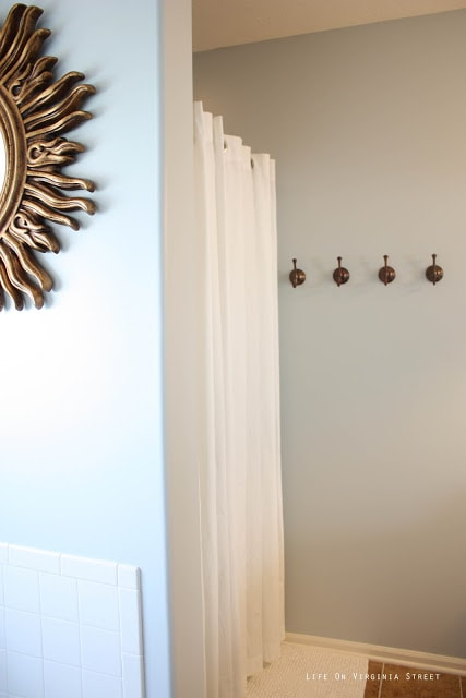Light Gray Master Bathroom with Gold and Bronze Accents and the sunburst mirror.