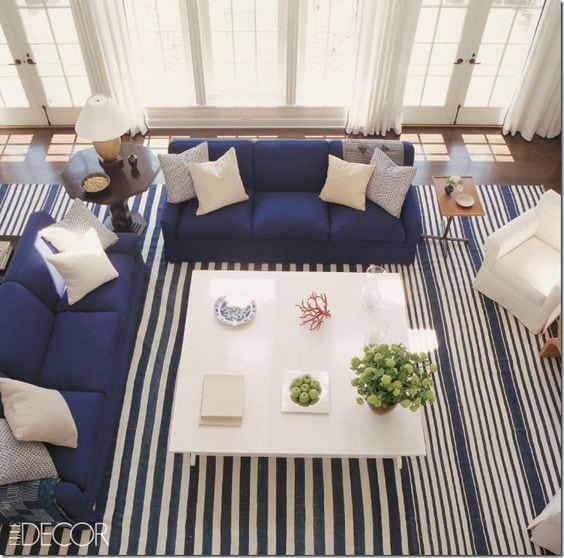 navy blue and white striped rug in a living room with navy couches