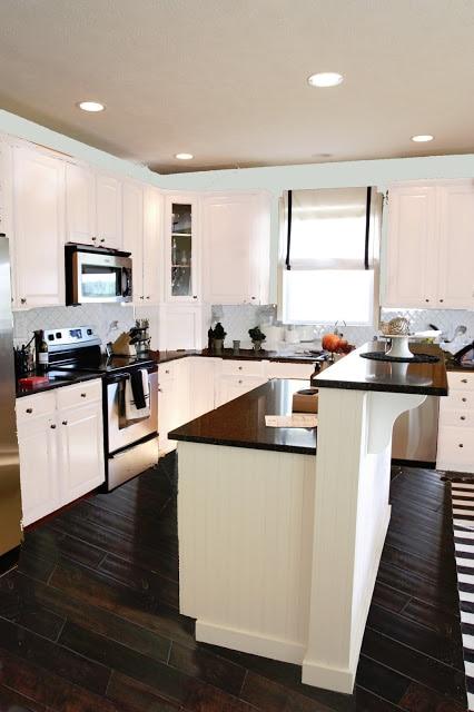 White kitchen with white subway tiles.