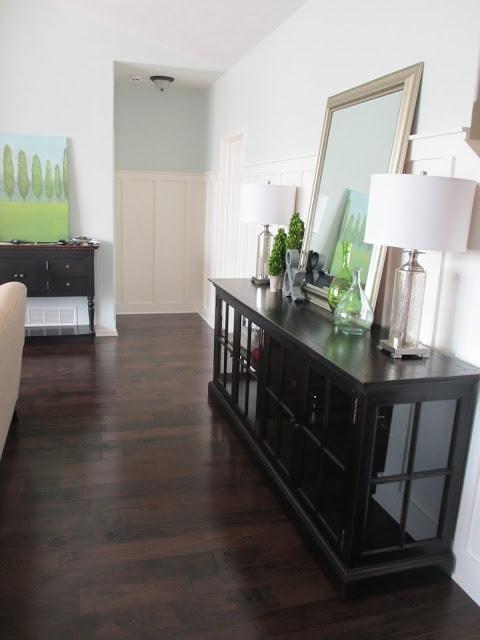 Living room with dark hardwood floors and Healing Aloe paint color walls