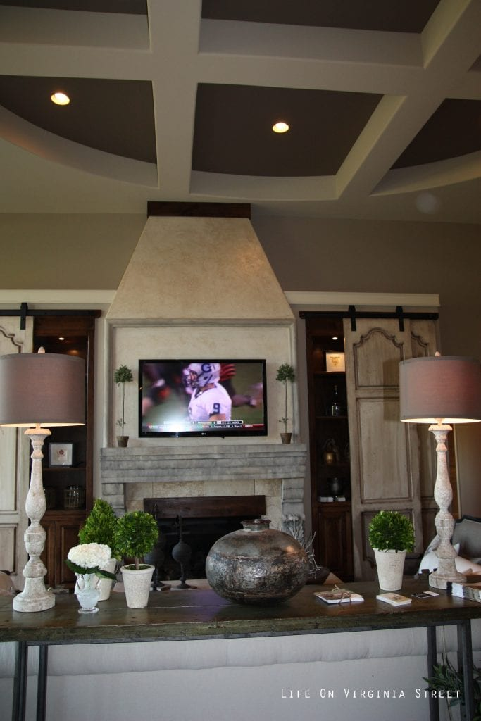 Gorgeous French-style entertainment center with wood shutters.