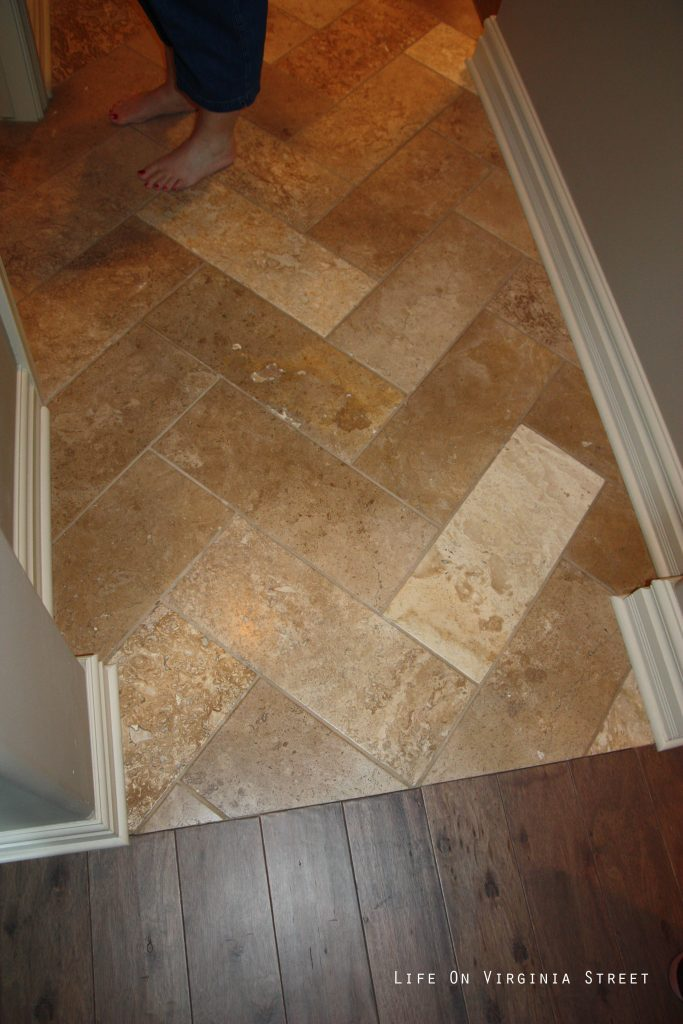Herringbone patterned travertine floors.