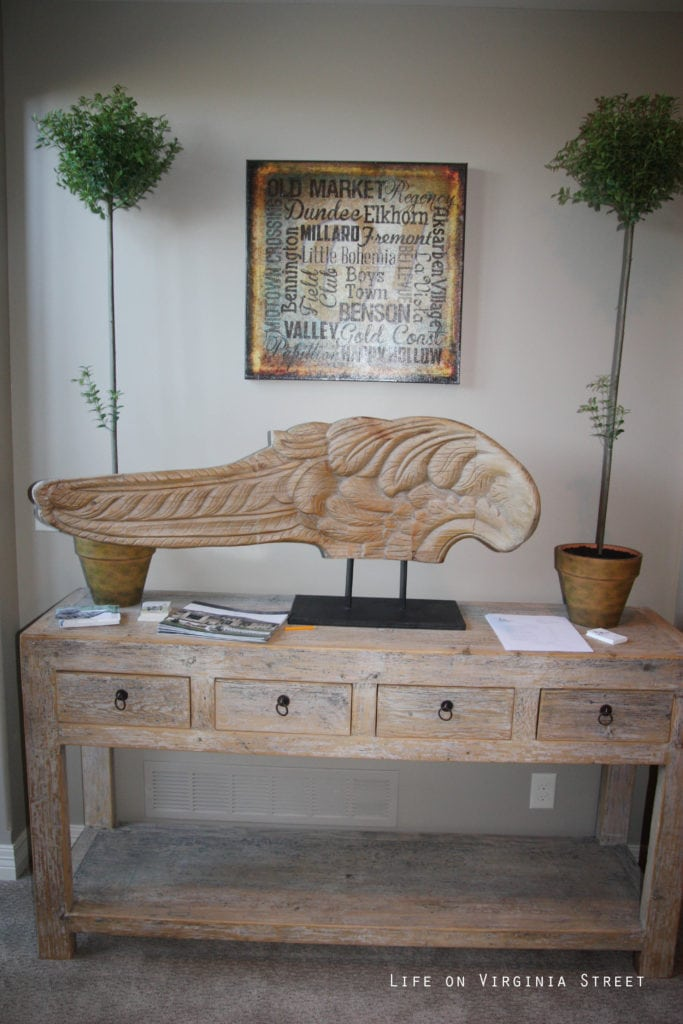 Carved wood angel wing.