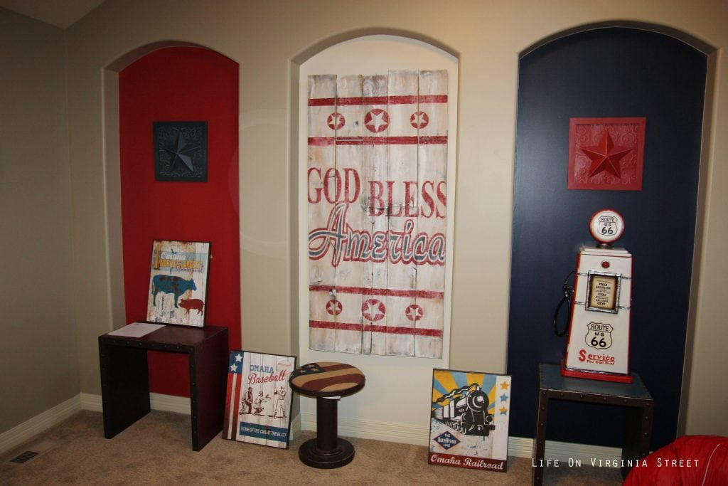 Patriotic loft playroom with red, white and blue nooks.