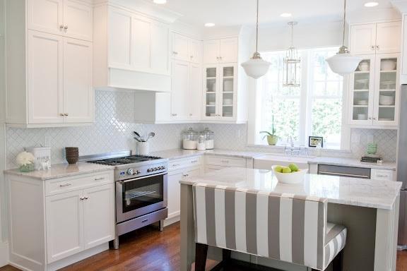 White kitchen with Moroccan tile backsplash.