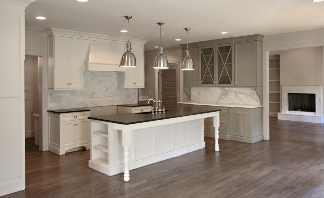 White kitchen cabinets, and Benson lights in the kitchen.