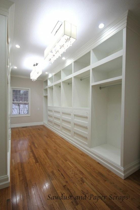 White closet with hardwood floors.