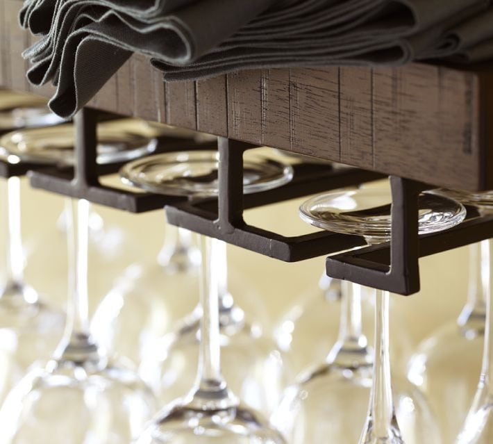 I love this option from crate and barrel. These wine bar shelves have a metal piece where your wine glasses hang from. Love the industrial element of the metal.
