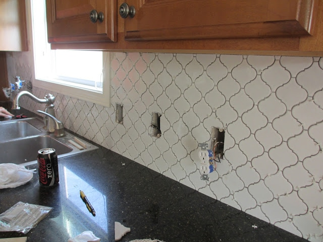 White Moroccan Tile backsplash ungrouted on the wall.