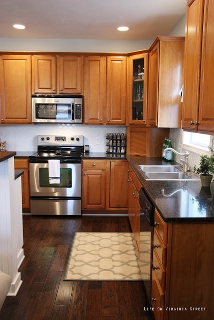 White Moroccan Tile backsplash in kitchen with stainless steel stove and microwave.