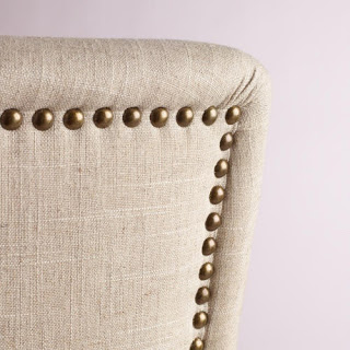 Up close picture of the rivet detailing on the back of the chair.
