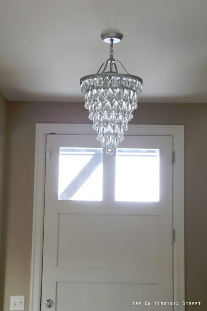 Cone shaped crystal chandelier in an entryway