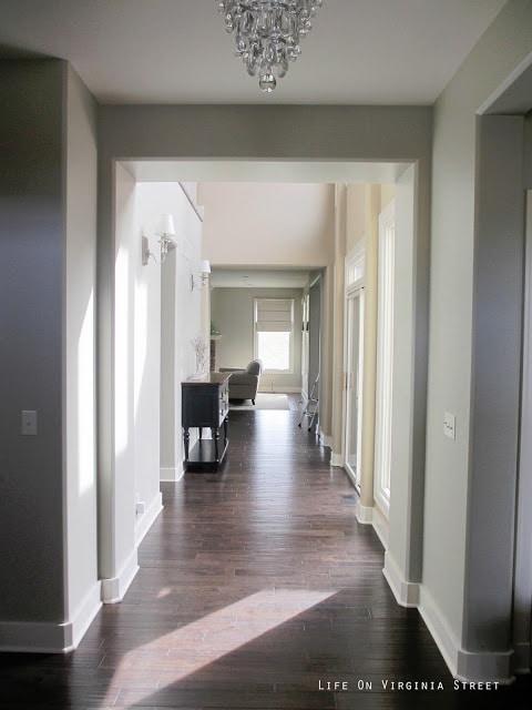 Hallway painted Behr Castle Path with Dark Oak Hardwood Floors