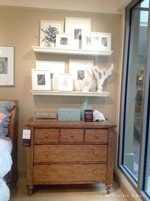 A creative way to display art work using a Pottery Barn picture frame ledge!
