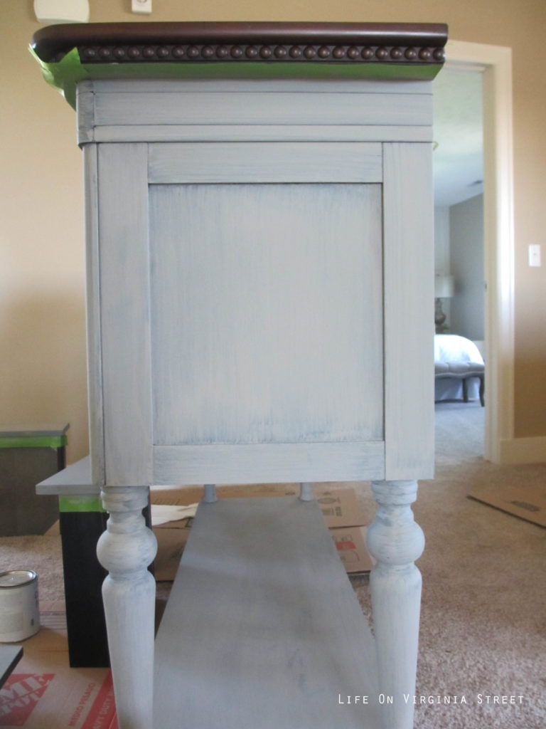 DIY chalk paint buffet project. One coat of gray chalk paint on a black buffet table.
