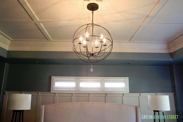 Showing off the Behr Atmospheric paint color on our master bedroom walls and the round light fixture.