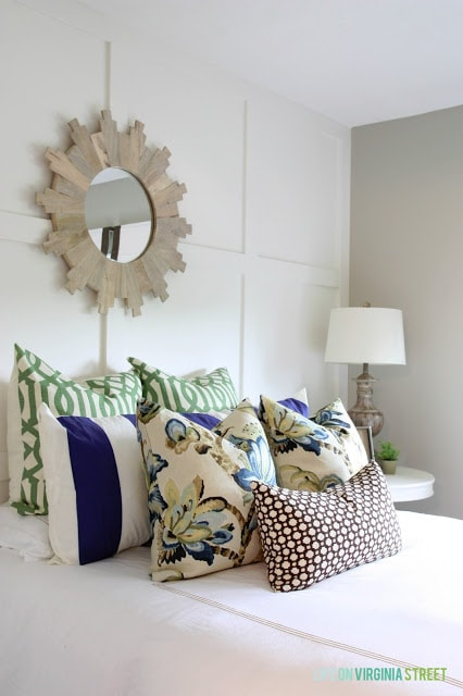 White Board and Batten Grid Wall with Designer Pillows on Bed