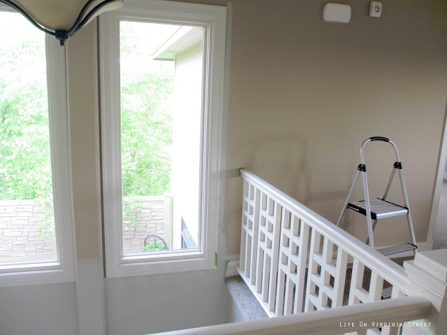 Painting the two-story entryway with Behr Castle Path