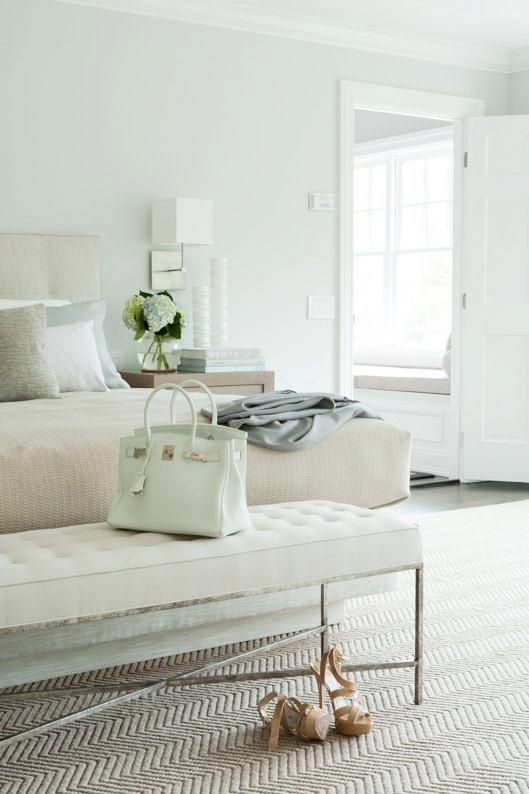 Seafoam light green on walls and neutral bedding and rug in master bedroom.