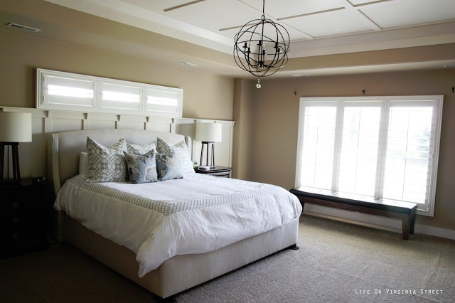 Neutral master bedroom with orb chandelier before painting. It's already a dark neutral color - should I go darker?