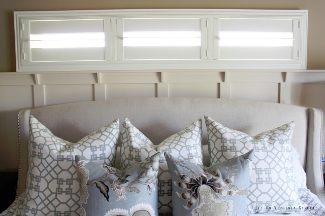 Master bedroom with Schumacher Hothouse Flowers and Windsor Smith Pelagos pillows. This headboard needs a little love, especially when compared to these gorgeous white shutters.