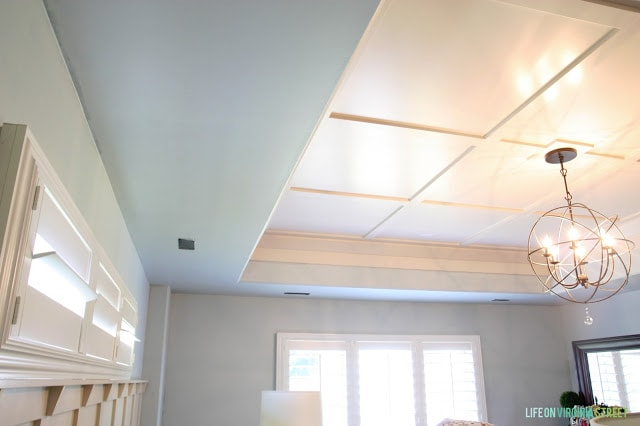 Master Bedroom with Sherwin Williams Sea Salt Walls and White board and batten ceiling with orb chandelier
