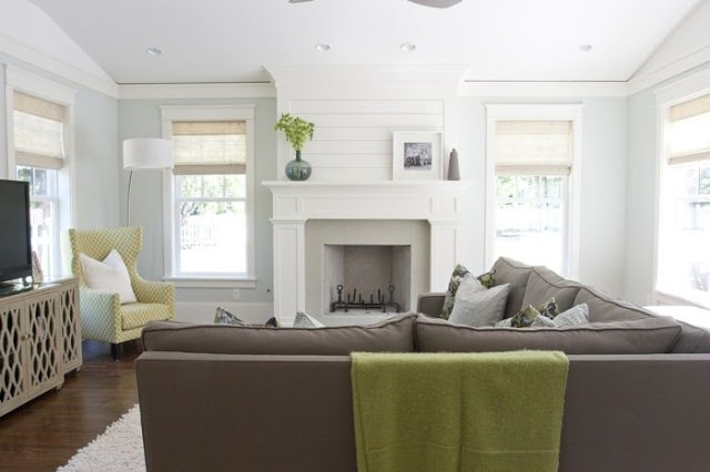 White fireplace with shiplap and Healing Aloe walls