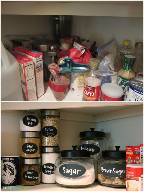 Glass jars with provisions in them all labelled on pantry shelf.