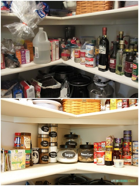 Glass jars in pantry on shelf with black labels.