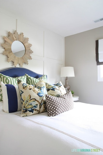 Gorgeous neutral guest bedroom with a blue headboard. Love the pillow fabric combo!