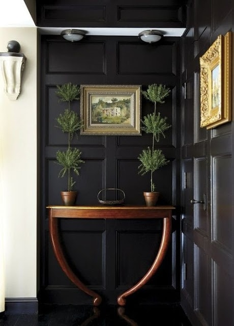Dark board and batten walls work in small spaces if you use light accents.
