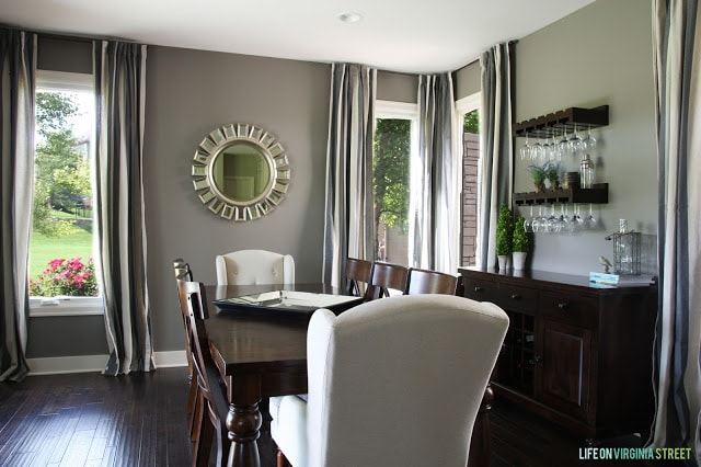 Dining room with charcoal gray walls