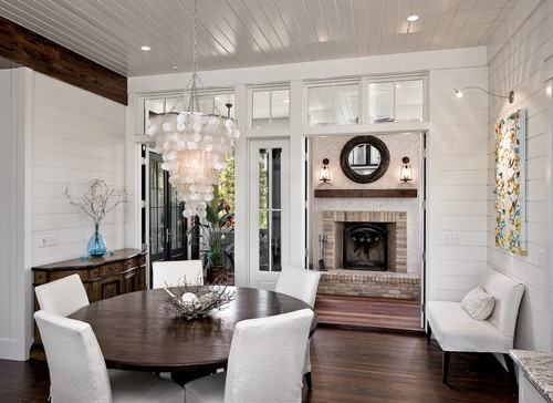 White planked walls add visual interest to this light and airy dining space.