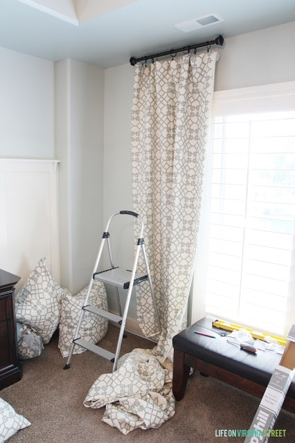 Sherwin Williams Sea Salt walls with Behr Swiss Coffee Trim and board and batten. I love the fabric for the curtain panels that pairs so well with the Sea Salt walls!