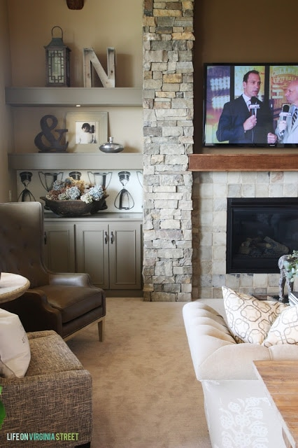 Stacked stone fireplace with gray built-in shelves. Love the look of this with the TV.