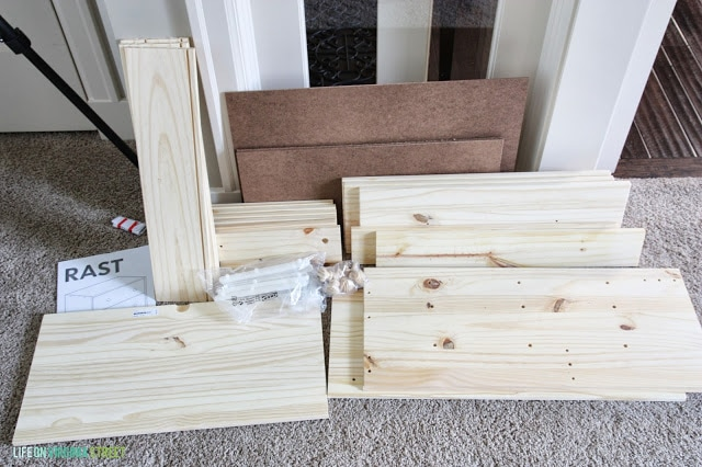 An ikea dresser in pieces before it is being assembled.