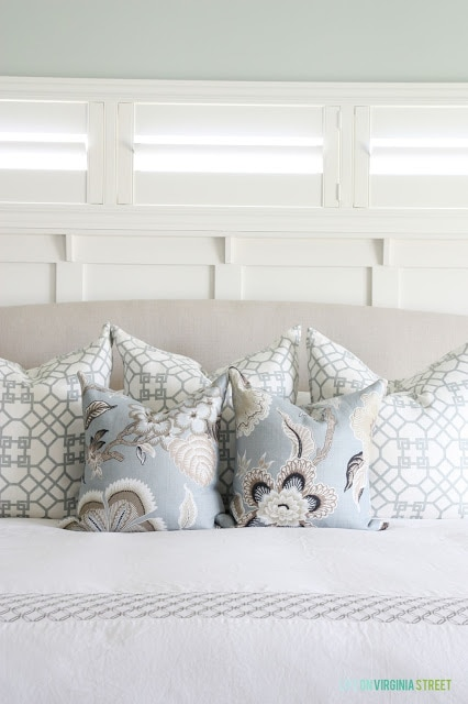 Soft blue floral pillow on the bed in the master bedroom.