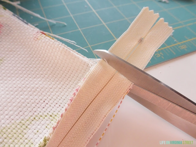 Cutting the excess zipper.