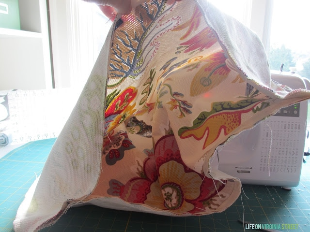 How to Make a Throw Pillow With a Zipper. This step shows flipping the fabric inside out.