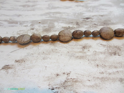 Up close of the wooden beads on a string.