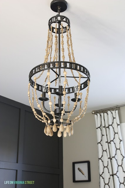 Wooden bead chandelier hanging up.