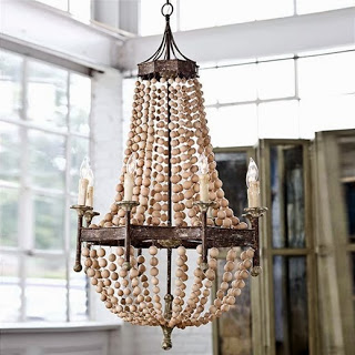 Wood and metal chandelier with faux candle lights on it.
