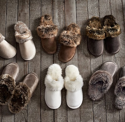 White, gray, dark brown and brown faux fur slippers.