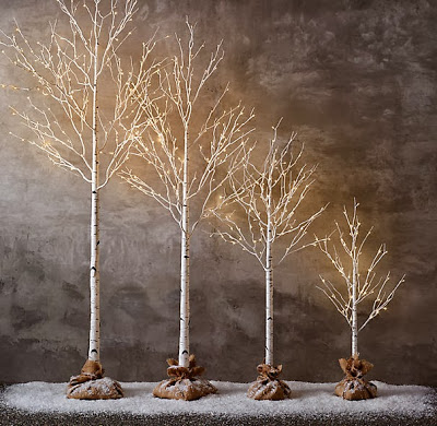 Various sizes of mini trees with lights.